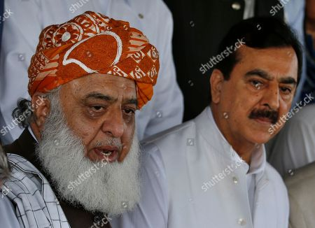 "Stock Image of Maulana Fazlur Rehman, Yousuf Raza Gilani. Maulana Fazlur Rehman, left, head of a Pakistani religious parties alliance speaks to journalists with former Prime Minister Yousuf Raza Gilani, a leader in the Pakistan People's Party, after their meeting in Islamabad, Pakistan, . Pakistan's political parties say they will join hands against the ""stolen mandate"" of Imran Khan, whose party won the most votes in an election marred by allegations of fraud"
