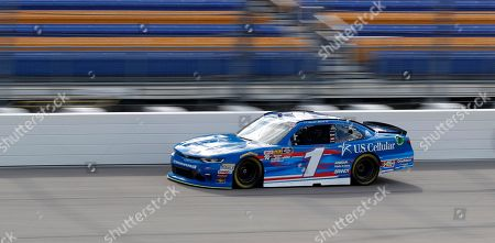 Elliott Sadler drives his car during a practice session for the NASCAR Xfinity Series auto race, at Iowa Speedway in Newton, Iowa