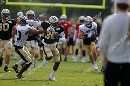 New Orleans Saints running back Shane Vereen (35) carries against safety Marcus Williams (43) Ryan Yurachekduring training camp at their NFL football training facility in Metairie, La