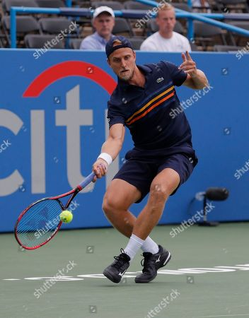 Stock Picture of Denis Kudla. Denis Kudla returns against Lukas Lacko of Slovakia during the first round of the Citi Open tennis tournament, in Washington