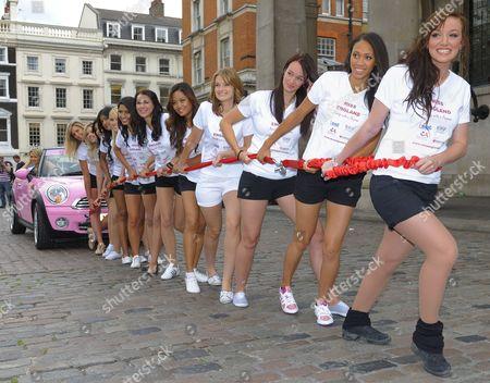 (right to left) - Katrina Hodge, Rachel Christie, Suzy Cumming, Katy Worth, Areerat Chosanthiah, Heather Twaits, Reema Mehta, Alexandra Williams, Farah Sattaur, Snehali Naik, Anna Watts, Charlotte Packham and Laura Coleman (winner of Miss England 2008, in car)