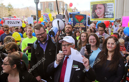 In this March 30, 2018, photo, Sam Young, center, speaks to a group of people demanding an end to one-on-one interviews between Mormon youth and lay leaders during a march to church headquarters, in Salt Lake City. Young, a Mormon man has launched a hunger strike, to bring attention to a campaign calling on church leaders to bring an end to closed door, one-on-one interviews between youth and lay leaders where sexual questions sometimes arise