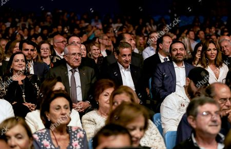 Stock Picture of Center row (R-L) Beiteddine Art Festival President Noura Jumblatt, Lebanese Prime Minister Saad Hariri ,former French President Nicolas Sarkozy and former Lebanese president Michel Suleiman attend the Italian-French singer-songwriter and former French first lady Carla Bruni performs on stage during a concert at the Beiteddine Art Festival 2018 in Beiteddine village, Lebanon, 30 July 2018.