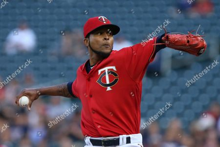 Minnesota Twins pitcher Ervin Santana throws against the Cleveland Indians in the first inning of a baseball game in Minneapolis