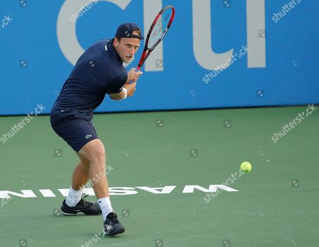 Denis Kudla, of the United States, eyes the ball as he returns to Lukas Lacko, of Slovakia, during the first round of the Citi Open tennis tournament, in Washington