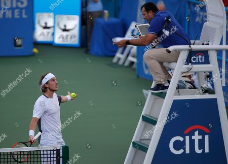 Lukas Lacko, Mohamed Fitouhi. Lukas Lacko of Slovakia speaks with chair umpire Mohamed Fitouhi during a challenge in his match against Denis Kudla during the first round of the Citi Open tennis tournament, in Washington