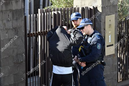 Police speak to a neighbour outside the house of Kings Cross nightclub owner John Ibrahim at Dover Heights in Sydney, Australia, 31 July 2018. Police said the operation was conducted in connection with serving of a firearms prohibition order.