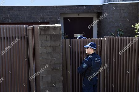 Police are seen outside the house of Kings Cross nightclub owner John Ibrahim at Dover Heights in Sydney, Australia, 31 July 2018. Police said the operation was conducted in connection with serving of a firearms prohibition order.