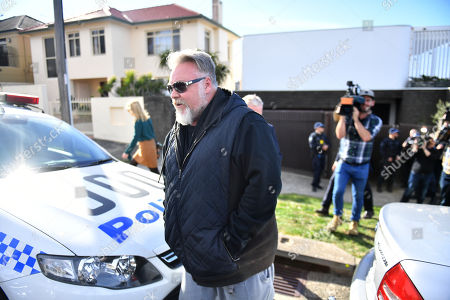 Radio host Kyle Sandilands arrives at the house of Kings Cross nightclub owner John Ibrahim during a police operation at Dover Heights in Sydney, Australia, 31 July 2018. Police said the operation was conducted in connection with serving of a firearms prohibition order.