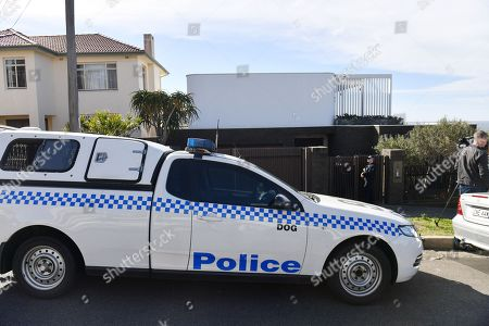 Stock Image of Police are seen outside the house of Kings Cross nightclub owner John Ibrahim at Dover Heights in Sydney, Australia, 31 July 2018. Police said the operation was conducted in connection with serving of a firearms prohibition order.