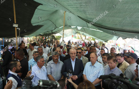 Palestinian Prime Minister Rami Hamdallah visits the Bedouin village of Khan al-Ahmar. Israel's supreme court on July 9 issued a new order temporarily suspending the evacuation of residents from a Palestinian Bedouin village in the occupied West Bank, expected to be demolished in the coming days. The order prevents Israeli authorities from razing Khan al-Ahmar until July 16 to allow time for residents to evacuate. Photo by Shadi Hatem