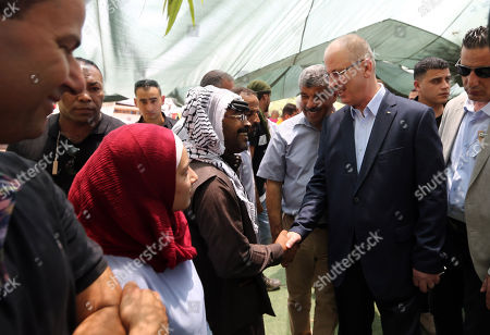 Palestinian Prime Minister Rami Hamdallah visits the Bedouin village of Khan al-Ahmar. Israel's supreme court on July 9 issued a new order temporarily suspending the evacuation of residents from a Palestinian Bedouin village in the occupied West Bank, expected to be demolished in the coming days. The order prevents Israeli authorities from razing Khan al-Ahmar until July 16 to allow time for residents to evacuate.