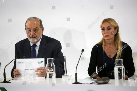 Mexican entrepreneur Carlos Slim (L), controlling shareholder of FCC group, and CEO of FCC, Esther Alcocer Koplowitz (R), present the company's results and its new strategies in Madrid, Spain, 31 July 2018.