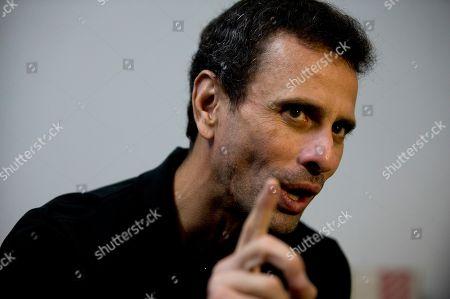 Venezuela's opposition leader Henrique Capriles speaks during an interview at his office in Caracas, Venezuela
