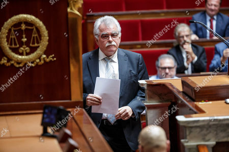 French communist party group president Andre Chassaigne (C) during a debate prior to a non-confidence vote against the government at the National Assembly in Paris, France, 31 July 2018. Parliamentary proceedings are disrupted by opposition MPs following the scandal of President Macron's security chief Alexandre Benalla after a video has been released on 19 July 2018 showing Benalla wearing a riot helmet and police uniform, allegedly attacking protesters during street demonstrations on 01 May 2018.