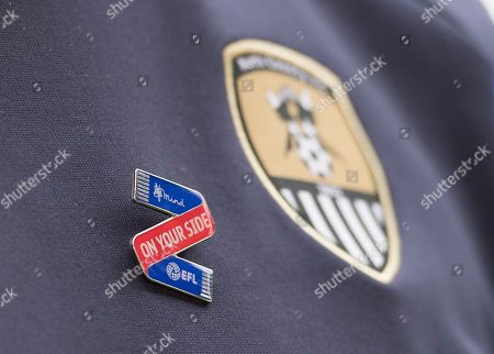The Mind On Your Side pin badge worn by Kevin Nolan, manager of Notts County, during the EFL 2018/19 season Launch press conference.