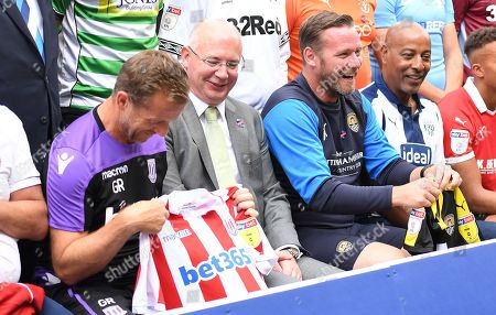 Gary Rowett, manager of Stoke City and Kevin Nolan, manager of Notts County hold team shirts watched by Shaun Harvey, EFL Chief Executive as they prepare for a team photograph representing all 72 clubs to launch the new EFL 2018/19 season.
