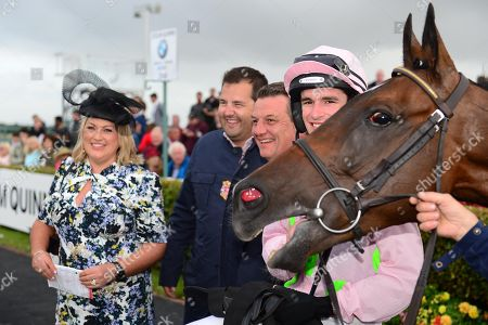 GALWAY. The Colm Quinn BMW Mile Handicap. RIVEN LIGHT and Danny Mullins win for trainer Willie Mullins pictured with sponsor COLM & LOUISE QUINN and JOE CHAMBERS fo absent owner RICH RICCI.