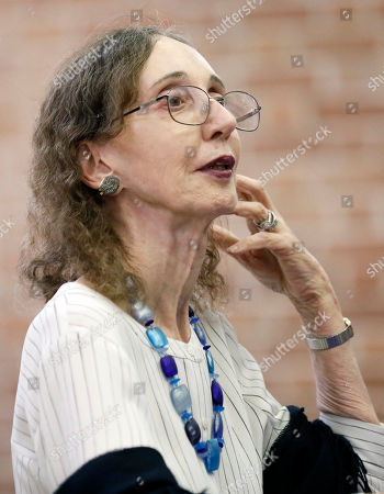 This is a photograph of American author Joyce Carol Oates, photographed at Millsaps College in Jackson, Miss., listens to a question during an question and answer period. Oates, published her first book in 1962. Oates has since published over 40 novels, as well as plays and novellas, short stories, poetry, and nonfiction