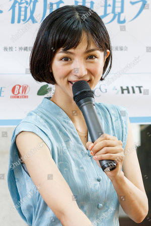 Japanese actress and singer Hikari Mitsushima speaks during a news conference at the National Museum of Nature and Science in Tokyo. The museum aims to collect 30 million yen to recreate the Japanese ancestors' journey between Taiwan and Yonaguni Island on a wooden dugout canoe.