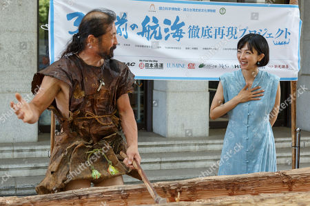 Japanese actress and singer Hikari Mitsushima (R) attends news conference at the National Museum of Nature and Science in Tokyo. The museum aims to collect 30 million yen to recreate the Japanese ancestors' journey between Taiwan and Yonaguni Island on a wooden dugout canoe.