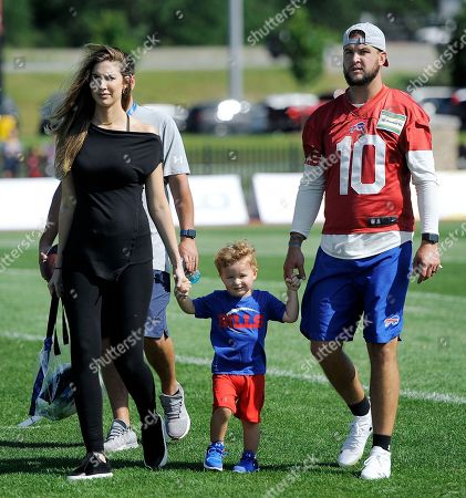 Stock Image of A.J. McCarron, Katherine Webb-McCarron. Buffalo Bills quarterback A.J. McCarron, right, walks with his wife Katherine Webb-McCarron and their son Tripp after practice at the NFL football team's training camp in Pittsford, N.Y