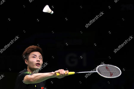 Shi Yuqi of China plays a shot while competing against Rajiv Ouseph of England during their men's badminton singles match at the BWF World Championships in Nanjing, China