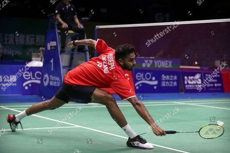 Stock Photo of Rajiv Ouseph of England plays a shot while competing against Shi Yuqi of China during their men's badminton singles match at the BWF World Championships in Nanjing, China