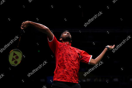 Rajiv Ouseph of England plays a shot while competing against Shi Yuqi of China during their men's badminton singles match at the BWF World Championships in Nanjing, China