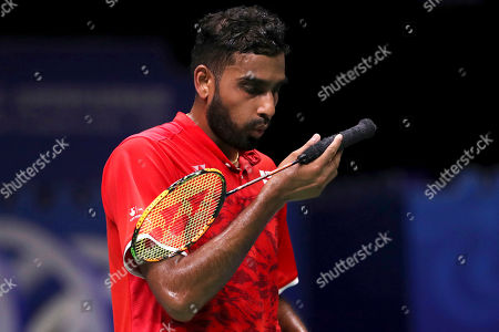 Stock Picture of Rajiv Ouseph of England reacts while competing against Shi Yuqi of China during their men's badminton singles match at the BWF World Championships in Nanjing, China