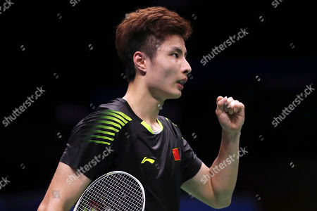 Shi Yuqi of China reacts while competing against Rajiv Ouseph of England during their men's badminton singles match at the BWF World Championships in Nanjing, China