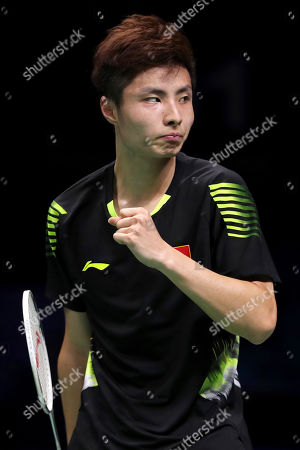 Stock Image of Shi Yuqi of China reacts while competing against Rajiv Ouseph of England during their men's badminton singles match at the BWF World Championships in Nanjing, China