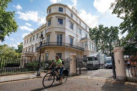Stock Image of Marina Wheeler QC, wife of former Foreign Secretary Boris Johnson, leaves the official residence of the Foreign Secretary at Carlton Gardens in central London by bicycle. A removals team has been seen packing possessions as Boris Johnson prepares to move out of the property after resigning as Foreign Secretary.