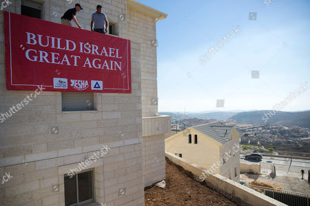A sigh placed prior to the visit of U.S. Governor Mike Huckabee where he will lay a brick at a new housing complex in the West Bank settlement of Efrat