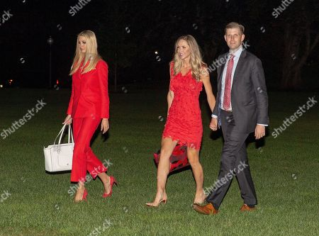 (L-R) Ivanka Trump, Lara Yunaska Trump and Eric Trump exit Marine One as they return from Tampa Bay, Florida to the White House