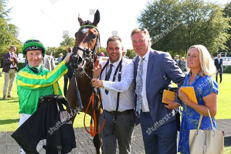 Stock Photo of FEEL GLORIOUS ridden by Pat Cosgrave with George Baker after winning The Victoria Racing Club Maiden Fillies' Stakes at Goodwood Copyright: Ian Headington/racingfotos.com