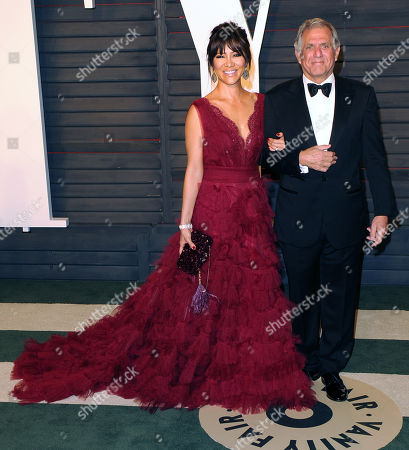 Stock Photo of Leslie Moonves and Julie Chen arrive at the Vanity Fair Oscar party in 2016. Leslie Moonves is currently facing sexual misconduct allegations as of July 2018.