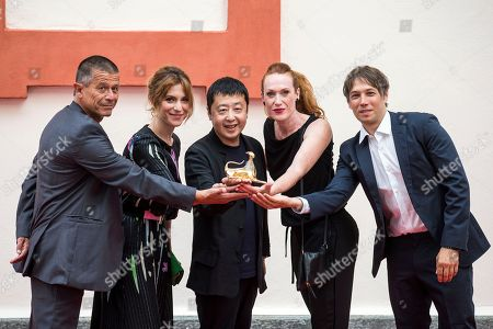 Stock Image of Members of the Concorso internazionale jury (L-R) French writer Emmanuel Carrere, Italian actress and playwright Isabella Ragonese, Chinese filmmaker Jia Zhang-ke, Italian-Austrian filmmaker Tizza Covi and US  filmmaker Sean Baker pose during a photocall at the 71st Locarno International Film Festival, in Locarno, Switzerland, 01 August 2018. The Festival del film Locarno 2018 runs from 01 to 11 August.