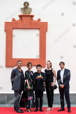 Stock Photo of Members of the Concorso internazionale jury (L-R) French writer Emmanuel Carrere, Italian actress and playwright Isabella Ragonese, Chinese filmmaker Jia Zhang-ke, Italian-Austrian filmmaker Tizza Covi and US  filmmaker Sean Baker pose during a photocall at the 71st Locarno International Film Festival, in Locarno, Switzerland, 01 August 2018. The Festival del film Locarno 2018 runs from 01 to 11 August.