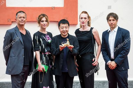 Stock Picture of Members of the Concorso internazionale jury (L-R) French writer Emmanuel Carrere, Italian actress and playwright Isabella Ragonese, Chinese filmmaker Jia Zhang-ke, Italian-Austrian filmmaker Tizza Covi and US  filmmaker Sean Baker pose during a photocall at the 71st Locarno International Film Festival, in Locarno, Switzerland, 01 August 2018. The Festival del film Locarno 2018 runs from 01 to 11 August.