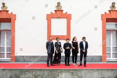Members of the Concorso internazionale jury (L-R) French writer Emmanuel Carrere, Italian actress and playwright Isabella Ragonese, Chinese filmmaker Jia Zhang-ke, Italian-Austrian filmmaker Tizza Covi and US  filmmaker Sean Baker pose during a photocall at the 71st Locarno International Film Festival, in Locarno, Switzerland, 01 August 2018. The Festival del film Locarno 2018 runs from 01 to 11 August.