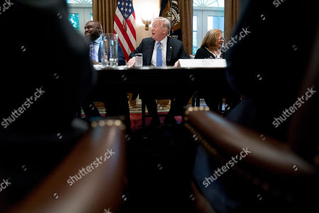Donald Trump, John Gray, Alveda King. President Donald Trump, accompanied by Relentless Church Senior Pastor John Gray, left, and Dr. Alveda King with Alveda King Ministries, right, jokes during a meeting with inner city pastors in the Cabinet Room of the White House in Washington