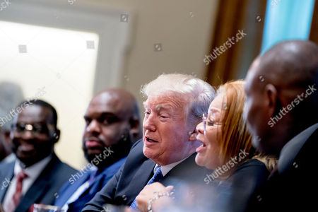Stock Picture of Donald Trump, Alveda King. President Donald Trump, center, reacts as Dr. Alveda King with Alveda King Ministries, second from right, speaks during a meeting with inner city pastors in the Cabinet Room of the White House in Washington