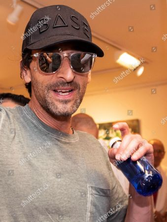 US actor Adrien Brody poses for the photographers during the inauguration of the exhibition by Spanish artist Domingo Zapata (unseen) at Ahoy Gallery in Palma de Mallorca, Balearic Islands, Spain, 01 August 2018.