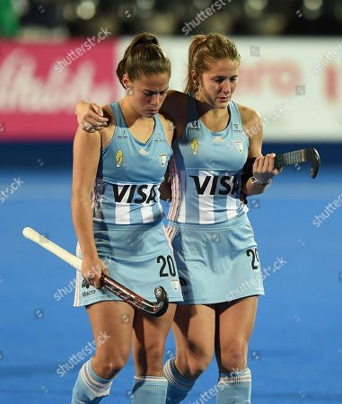 Lucina Von Der Heyde of Argentina and Julia Gomes Fantasia of Argentina look dejected as they leave the field