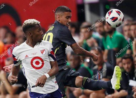 Juventus midfielder Matheus Pereira, right, works against MLS All-Star defender Michael Amir Murillo during the MLS All-Star soccer match, in Atlanta