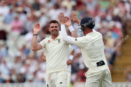 James Anderson of England celebrates taking the wicket of Mohammed Shami of India with Keaton Jennings