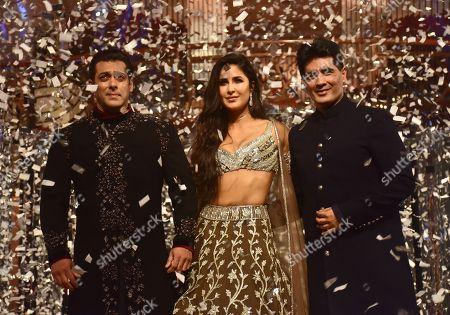 Indian film actor Salman Khan (L) and Katrina Kaif (C) with designer Manish Malhotra (R) walk the ramp for designer Manish Malhotra's Haute Couture 2018