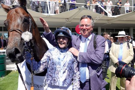 Katie Forest with owner George Baker the trainer of Harry Hurricane wins the Magnolia Cup