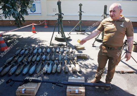 Chief Military Prosecutor of Ukraine Anatoliy Matios shows for journalists the weapons and ammunition as stated confiscated from Nadiya Savchenko and Volodymyr Ruban during a press-conference on the Ukrainian Security Service base near Kiev, Ukraine, 02  August 2018. Former Ukrainian lawmaker Nadiya Savchenko and  Head of Ukrainian center for hostage release 'Officer Corps' Volodymyr Ruban are accused of planning 'a large-scale terrorist act' in Kiev with the use of 120mm calibre mortars, small arms, sniper rifles, combat grenades for the overthrow of the constitutional system and seizure of state power.